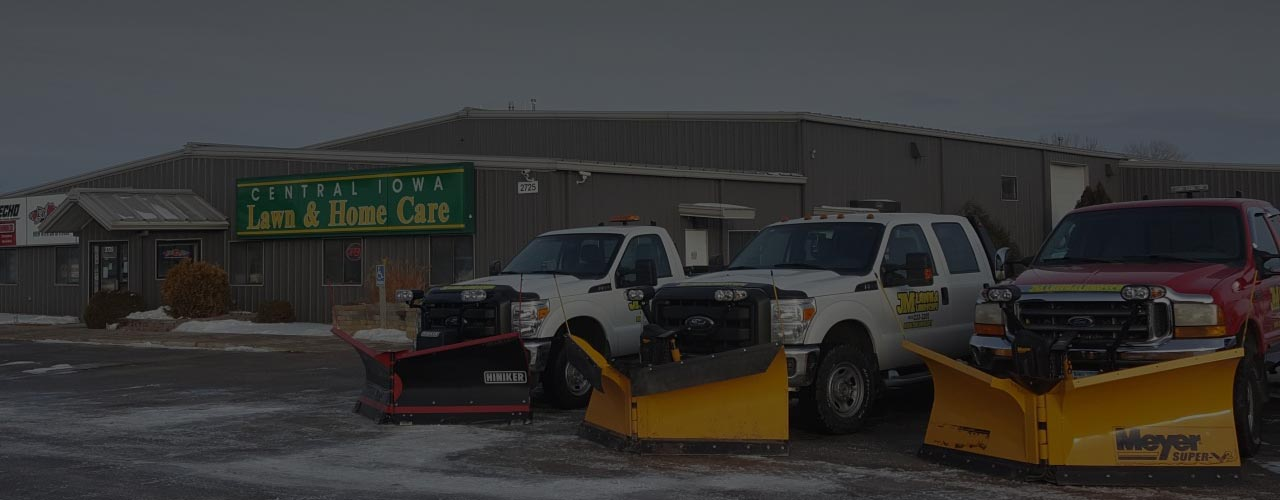 Snow plows outside of central iowa lawn & home care in ames